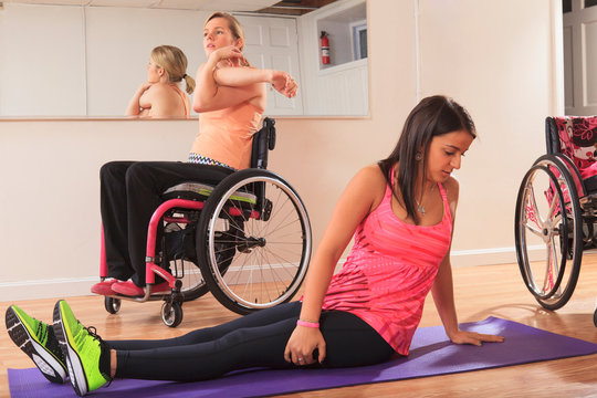 Women with spinal cord injury doing yoga