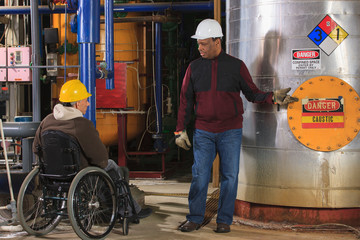 Power plant engineers, one in wheelchair