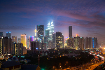 Photo Stands Kuala Lumpur Kuala Lumpur City skyline and skyscraper with highway road at night in Kuala Lumpur, Malaysia. Asia. Malaysia tourism, modern city life, or business finance and economy concept