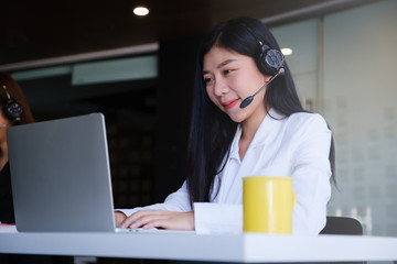Beautiful business woman or call center workers in headphones for communication and consulting people. Support concept.