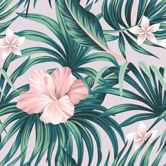 Tropical pink hibiscus and plumeria floral green palm leaves seamless pattern purple background. Exotic jungle wallpaper.