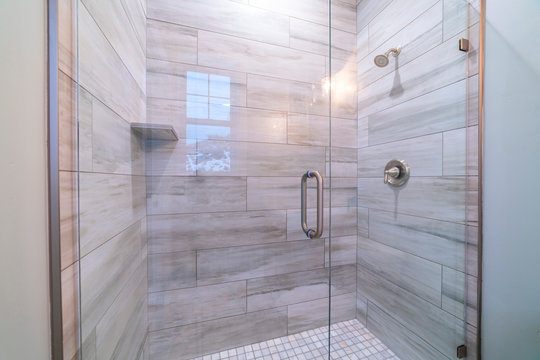 Large modern tiled shower cubicle bright interior