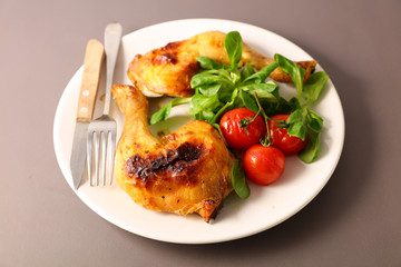 grilled chicken leg and salad in plate