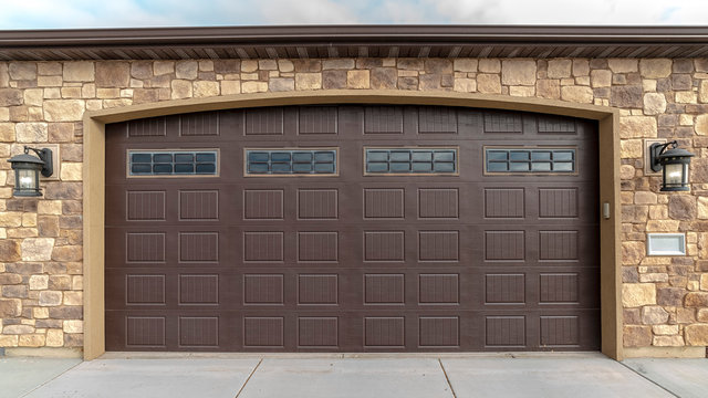 Panorama frame Large garage with double brown wooden door