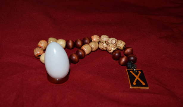 Beads in rosary for reading prayers and mantras with yoni egg from white agate