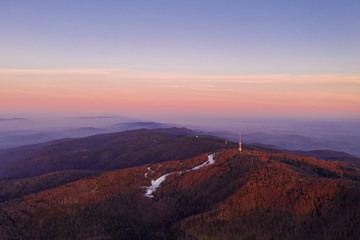 Zagreb Skyline in Croatia. Sunset Light Colorful Sky and TV Tower in Background. View from the top of Medvednica Mountain.  Haze Background.