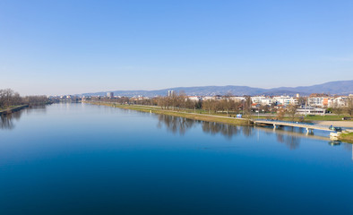 Beautfiful Jarun Lake in Zagreb, Croatia with Zagreb Cityscape in Background.