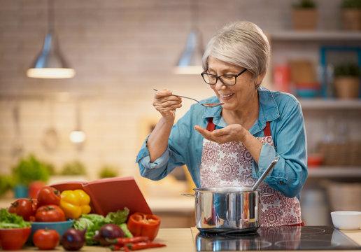 woman is preparing vegetables