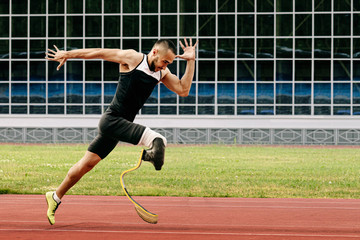 athlete runner physically disabled run on track of stadium