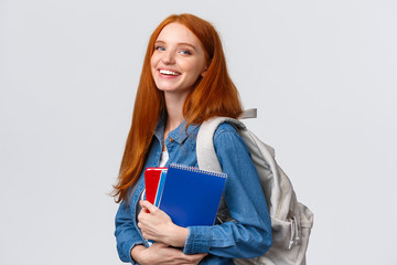 Teenagers, students and education concept. Cheerful lovely redhead female studying, going to...