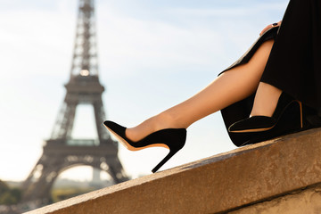 Wall Murals Eiffel Tower Paris fashion. Dress, shoes on high heels on the background of the Eiffel Tower