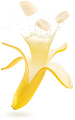 Wall Mural - juice splashing out of an open and sliced banana floating isolated on white background
