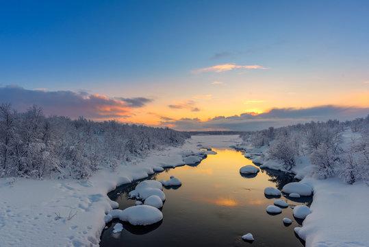 Winter sunset over the Teriberka river above the Arctic Circle in the Kola Peninsula, near Murmansk, Russia