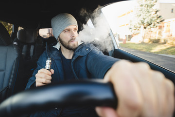 Vaping an electronic cigarette whilst driving in car