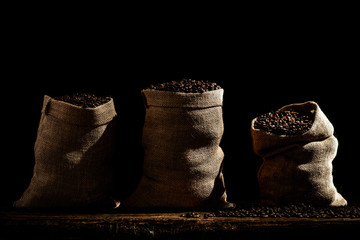 Fototapete - desk of free space and coffee beans in sacks.