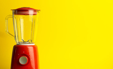 Vintage blender for cocktails and homemade food. Red blender on a yellow background. Minimal art concept, copy space