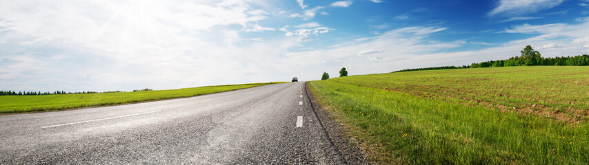Wall Mural - Road panorama on sunny spring day outdoors