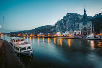 Poster Ship Historic town of Dinant with river Meuse at night, Wallonia, Belgium