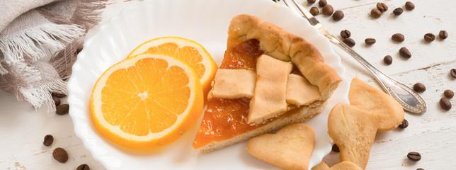 top view slice of pie with orange citrus jam and biscuits