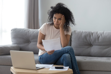 African woman received utility bills feels concerned about price increase