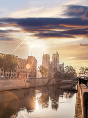Wall Mural - Notre Dame cathedral against sunrise in Paris, France