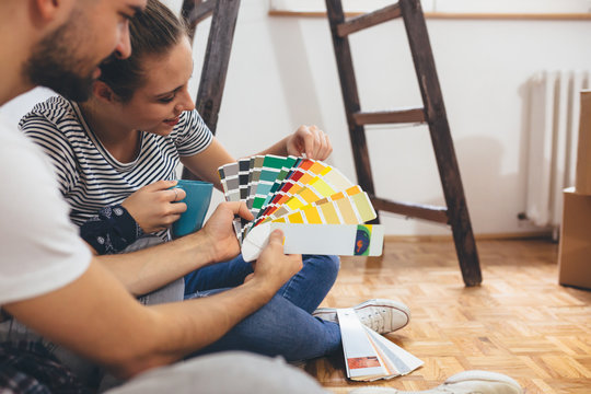 happy couple choosing color for inner walls