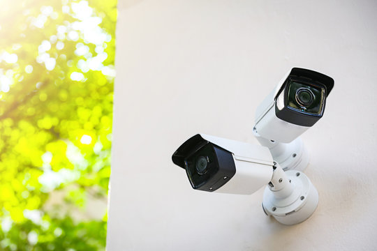 Outdoor CCTV monitoring, security cameras with sunlight flare.