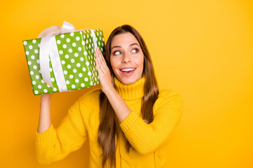 Interesting what is it. Amazed funky teen girl get big giftbox with white ribbon for anniversary she wait all life wear casual style jumper isolated over bright color background