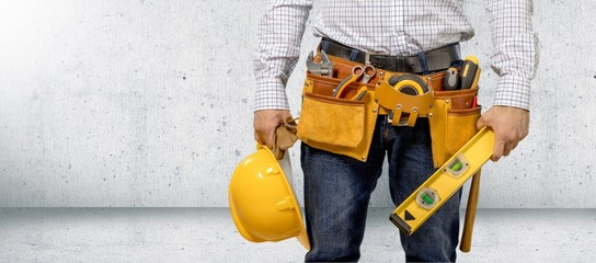 Man worker and professional builder with tools