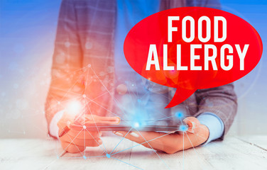 Writing note showing Food Allergy. Business concept for an abnormal immune response after eating a...