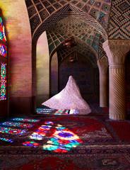 Woman wearing traditional Iranian dress walking through Pink Mosque, Shiraz, Iran