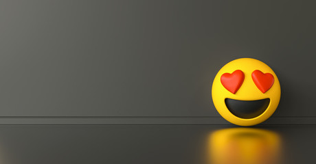 Smile in love emoticon ob dark gray background, social media and communications concept image, banner size, copyspace for your individual text.