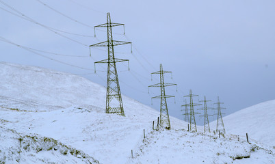 Electricity pylons carrying the Beauly-Denny powerline are seen close to the A9 road