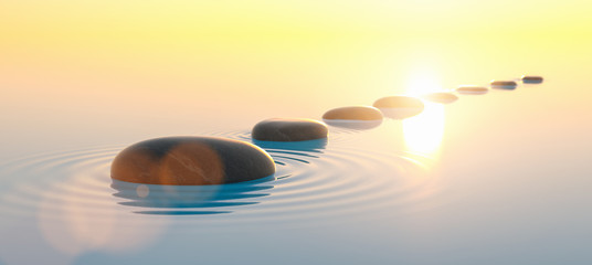 Deurstickers Zen Row of stones in calm water in the wide ocean, meditation and zen concept image