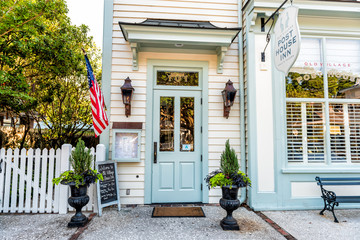 Mount Pleasant, USA - May 11, 2018: Charleston South Carolina with old street road and post house inn hotel small building entrance