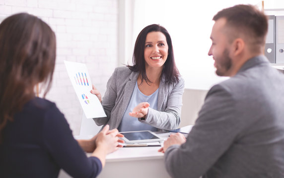 Cheerful expert explaining investment plan to new clients