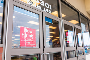Sterling, USA - November 21, 2019: Ross storefront with sign by entrance of store in Fairfax county, Virginia for hiring