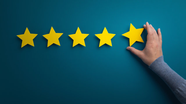 Business woman pointing five star to increase the rating