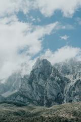 Rough rocks of Himalaya mountain range on calm foggy day in Tibet, China