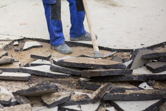 Manual removal of asphalt pavement with a pickaxe