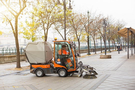 Small, compact, multifunctional municipal vacuum utility sweeper sweeper cleans Budapest street