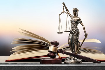 Sculpture justice bronze lady and open books and gavel