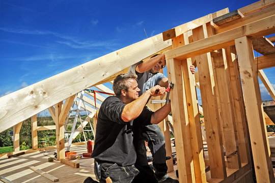 Carpenters Setting up a Half-timbered Building and the Roof Structure