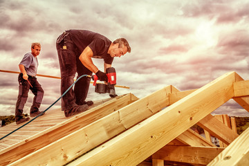 Carpenters Setting up a Roof Structure