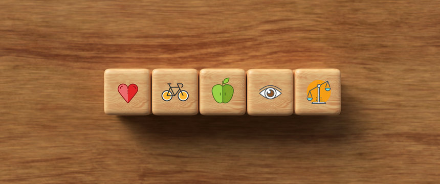 cubes with health icons on wooden background
