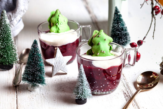 Cups of red porridge with green macaroon Christmas trees