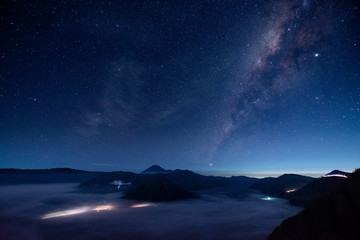 Indonesia, East Java, Scenic view of Milky Way galaxy on starry night sky over Mount Bromo shrouded in fog
