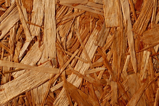 Recycled wood texture from compressed wood chippings and strands or oriented strand board, osb