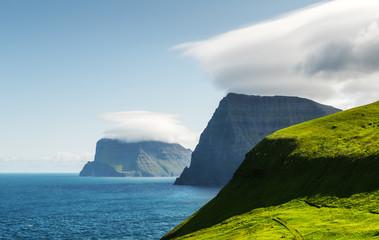 Green summer Islands in Atlantic ocean from Kalsoy island, Faroe Islands, Denmark. Landscape photography