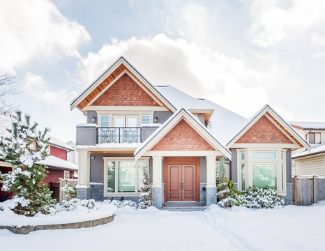 A perfect neighbourhood. Houses in suburb at Winter in the north America. Luxury houses covered nice snow.